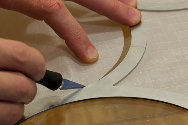 cutting circles from fabrics like dacron and other synthetics cutting ripstop nylon circles closeup with xacto knife