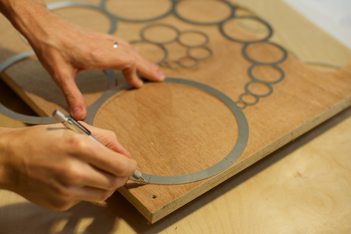 WindFire Designs Circle Tool shown as a quick way to mark a radius the corner of plywood