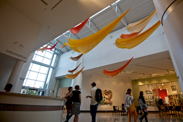 Tim Elverston and Ruth Whiting show kites at the Harn Museum in Gainesville FL