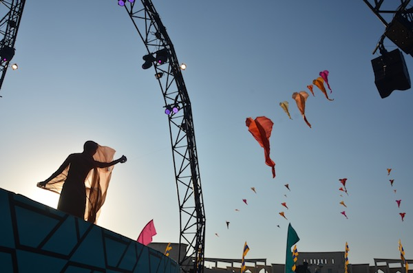 Ruth Whiting on stage in Doha flying show kites