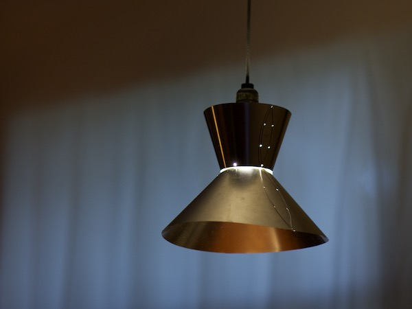 3-axis hover light by Tim Elverston with stainless steel shade hand sewn