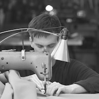 kite repair service by windfire designs - tim elverston sewing a kite surfting kite