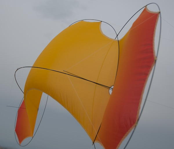 O2 Flame - quadline kite - silk shape in the wind from the rear