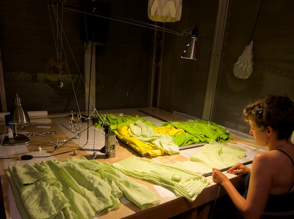 Ruth Whiting building Flowx kites on a work table at windfire designs