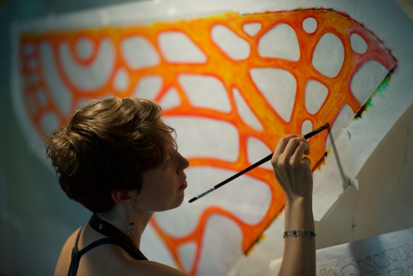Ruth Whiting painting a test for a colorwing morpho glider