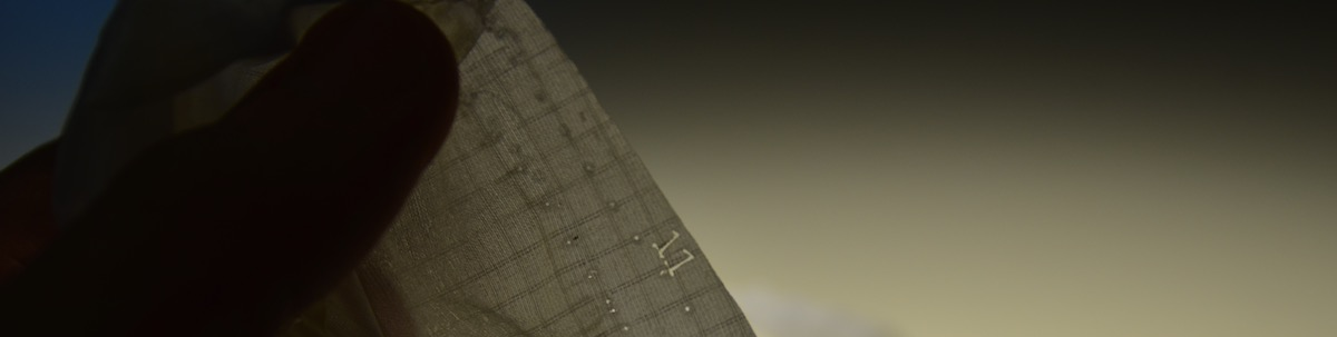 repair in progress of flysurfer speed rib stitching detail showing laser cut numbers for cell coding in manufacturing