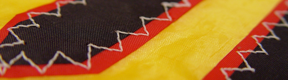 detail of stitching patch on a kite sail